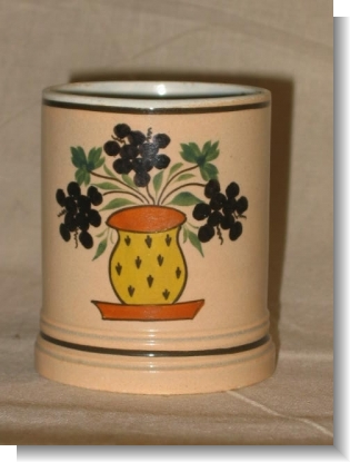 Small SLIP DECORATED AND PAINTED MUG.