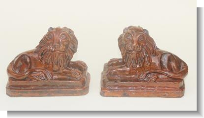 PAIR OF PILL POTTERY LIONS, SWANSEA c.1860