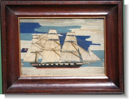 A CHARMING SMALL SHIP WOOLWORK PICTURE.