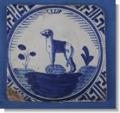 GOOD 17th Century DUTCH DELFT TILE of a DOG, c.1640.